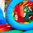Cute happy kid, boy playing in inflatable attraction on playground — Stock Photo #74555741