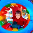 Cute happy kid, boy playing in inflatable attraction on playground — Stock Photo #74555745