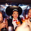 Group of happy elegant women clinking glasses in limousine, hen party — Stock Photo #75033219