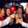 Group of happy elegant women clinking glasses in limousine, hen party — Stock Photo #75033225