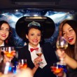 Group of happy elegant women clinking glasses in limousine, hen party — Stock Photo #75033237
