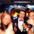 Group of happy elegant women clinking glasses in limousine, hen party — Stock Photo #75033239