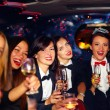 Group of happy elegant women clinking glasses in limousine, hen party — Stock Photo #75033253