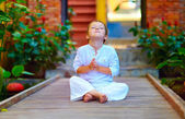 Cute boy trying to find inner balance in meditation — Stock Photo