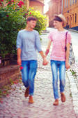 Happy male couple walking the city street, defocused — Stock Photo