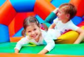 Happy kids having fun on playground in kindergarten — Stock Photo