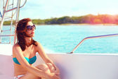 Happy young woman enjoys summer vacation in sea cruise — Stock Photo