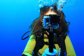 Scuba diver with action camera — Stock Photo