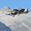 Sports aircraft with pilot in the mountains — Stock Photo #59859723