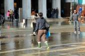 Venice sinking beneath the sea, people wearing rubber boots — Stock Photo
