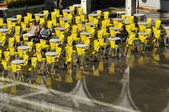 Venice sinking beneath the sea, with people in chairs — Stock Photo