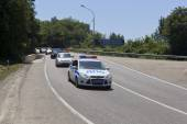 Escort of police cars on road — Stock Photo