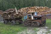 """Old tractor DT-75 """"Kazakhstan"""" waste removal from sawmills — Stock Photo"""