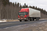 Scania commercial vehicle driving on M8 highway in Russia — Stock Photo