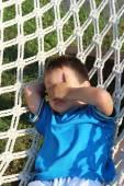 Chico en una hamaca — Foto de Stock