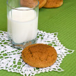 Glass of milk and oat cookies. — Stock Photo #63834495