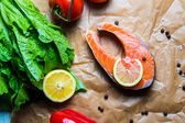Fresh salmon steak with herbs and vegetables — Stock Photo