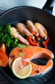 Fresh salmon steak in a pan grilled shrimp and vegetables — Stock Photo