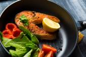 Grilled fish steak with vegetables — Stock Photo
