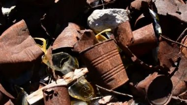 Pan of Rusting Tin Cans — Stock Video