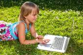 Child with computer outdoor  — Stock Photo