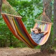 Child relaxing in hammock outdoors — Stock Photo #58805267