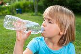 Little girl drinking water — Stock Photo