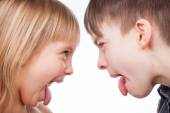 Siblings sticking out tongues — Stock Photo