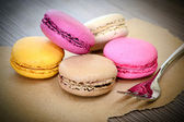 Sweet Tasty Macaroons on Wooden Background — Stock Photo