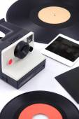 Old instant camera with vinyl and instant photos - eighties — Stock Photo