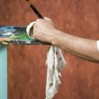 Detail of painters hand with brush and rag — Stock Photo #61739243