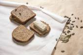 Different kinds of bred with tofu cheese and pumpkin seeds — Stock Photo