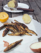 Vertical image of fried smelt fish — Stock Photo