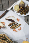 Vertical composition of fried smelt fish — Stock Photo