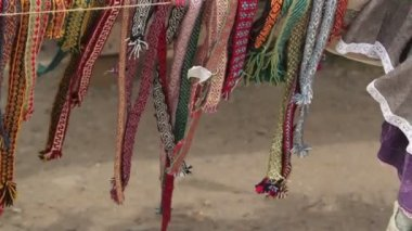 Multicolored knitted ribbons swaying in the wind — Stock Video