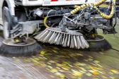 Truck cleaning street at autumn — Stockfoto