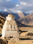 Buddhist stupas near the Shey monastery against the Himalayas mo — Stock Photo