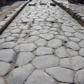 Ancient road with original ruts in the stone, Pompeii — Stock Photo