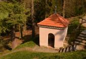 A small empty chapel in the woods — Stock Photo
