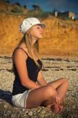 Blonde in a cap — Stock Photo