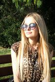 Portrait of a blonde in leopard jacket — Stock Photo