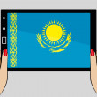 Tablet with flag of Kazakhstan — Stock Vector #52126199