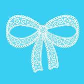 Decorative lacy bow on blue background  — Stock vektor