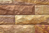 Sand stone wall surface, background of decorate - wallpaper — Stock Photo