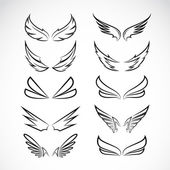 Vector black wing icons set on white background — Stock Vector