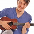 Young man playing a little guitar. — Stock Photo #57538397