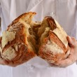 Chef holding fresh bread — Stock Photo #59526197
