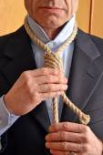 Hangman adjusting a noose rope — Stock Photo