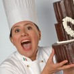 Woman holding a big chocolate cake. — Stock Photo #76128107