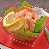 Shrimp cocktail on lettuce — Stock Photo
